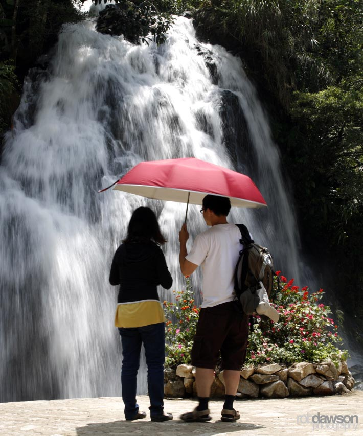 Tourists watch the waterfall in Cat Cat village in Sapa, northern Vietnam September 17, 2012
