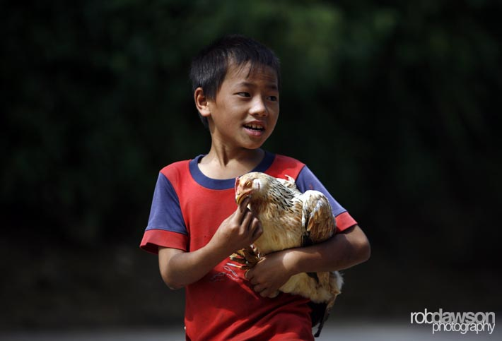 A boy carries a chicken along the streets of Sapa, northern Vietnam September 17, 2012